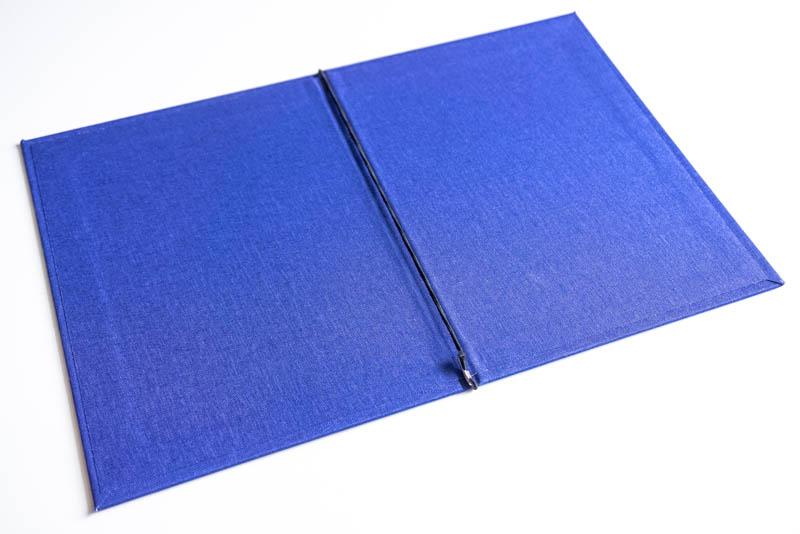 Крепление листов на резинки в папках